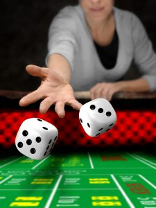 woman throw dices on casino table